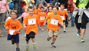 Ogden Classic child participants race their way through the streets of Wheeling.